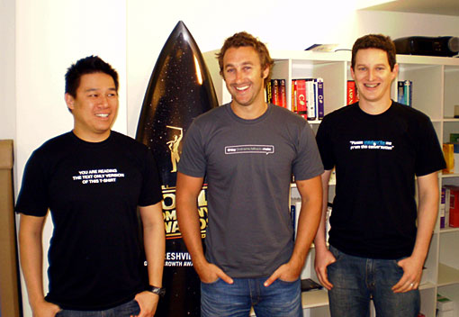 Ken, Dave and Mat in front of our 'Cool Company' surfboard